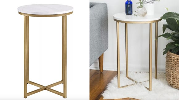 Class up your living room with a gold and marble table.