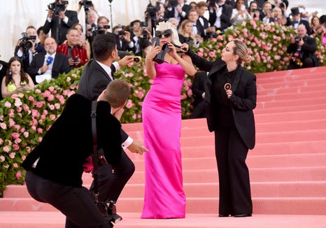Look No. 3: It's not over! Gaga shed her black gown to reveal a body-skimming hot pink dress, sunglasses and a giant retro cellphone.