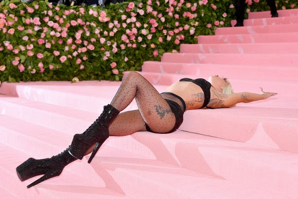 Look No. 4: Gaga lies on the Met Gala stairs in her final look: A sparkly bra, underwear, fishnets and sky-high boots.