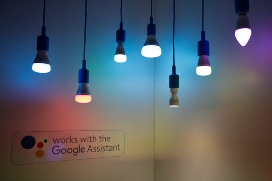 FILE - In this Jan. 10, 2018, file photo Wiz's Google Assistant-enabled smart LED lights are displayed at CES International in Las Vegas.