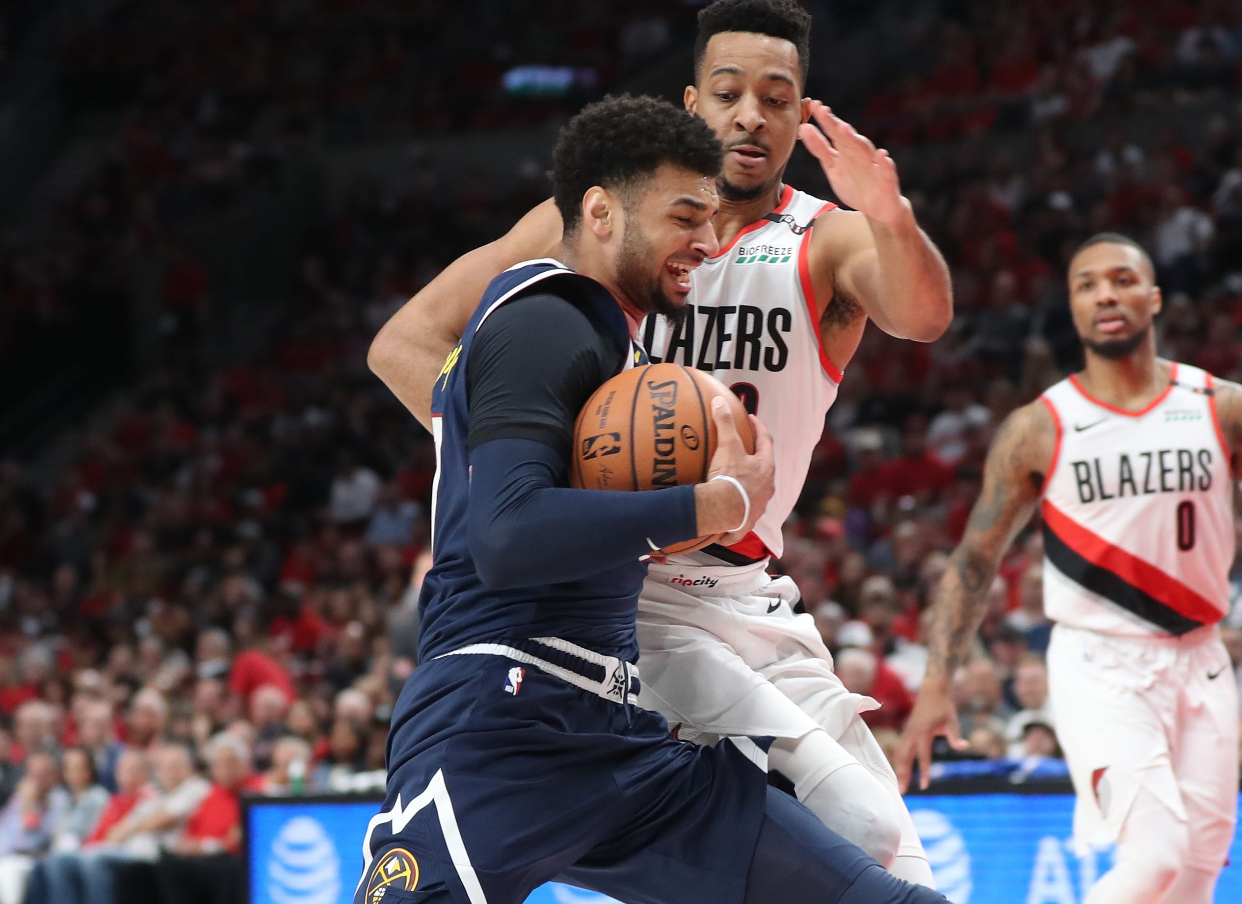 May 5: Nuggets guard Jamal Murray (27) tries to drive against Trail Blazers defender C.J. McCollum (3) during Game 4 in Portland.
