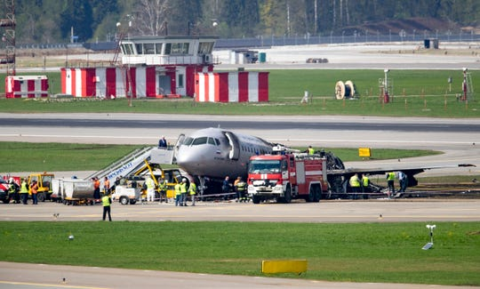 The Sukhoi SSJ100 aircraft of Aeroflot Airlines, after making an emergency landing in Sheremetyevo airport, outside Moscow, Russia, Monday, May 6, 2019. Russia's main investigative body says both flight recorders have been recovered from the plane that caught fire while making an emergency landing at Moscow's Sheremetyevo Airport, killing at least 40 people. (AP Photo/Pavel Golovkin) ORG XMIT: XAZ107