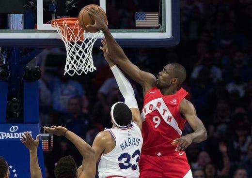 May 5: Raptors defender Serge Ibaka (9) blocks the shot attempt by 76ers forward Tobias Harris (33) during Game 4.