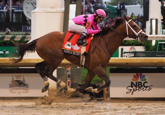 Maximum Security crosses the finish line first during the Kentucky Derby, but the horse was later disqualified for a foul.