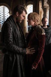 Euron Greyjoy (Pilou Asbaek), left, plans a land-sea marriage alliance with Cersei Lannister (Lena Headey) as Qyburn (Anton Lesser) looks on.