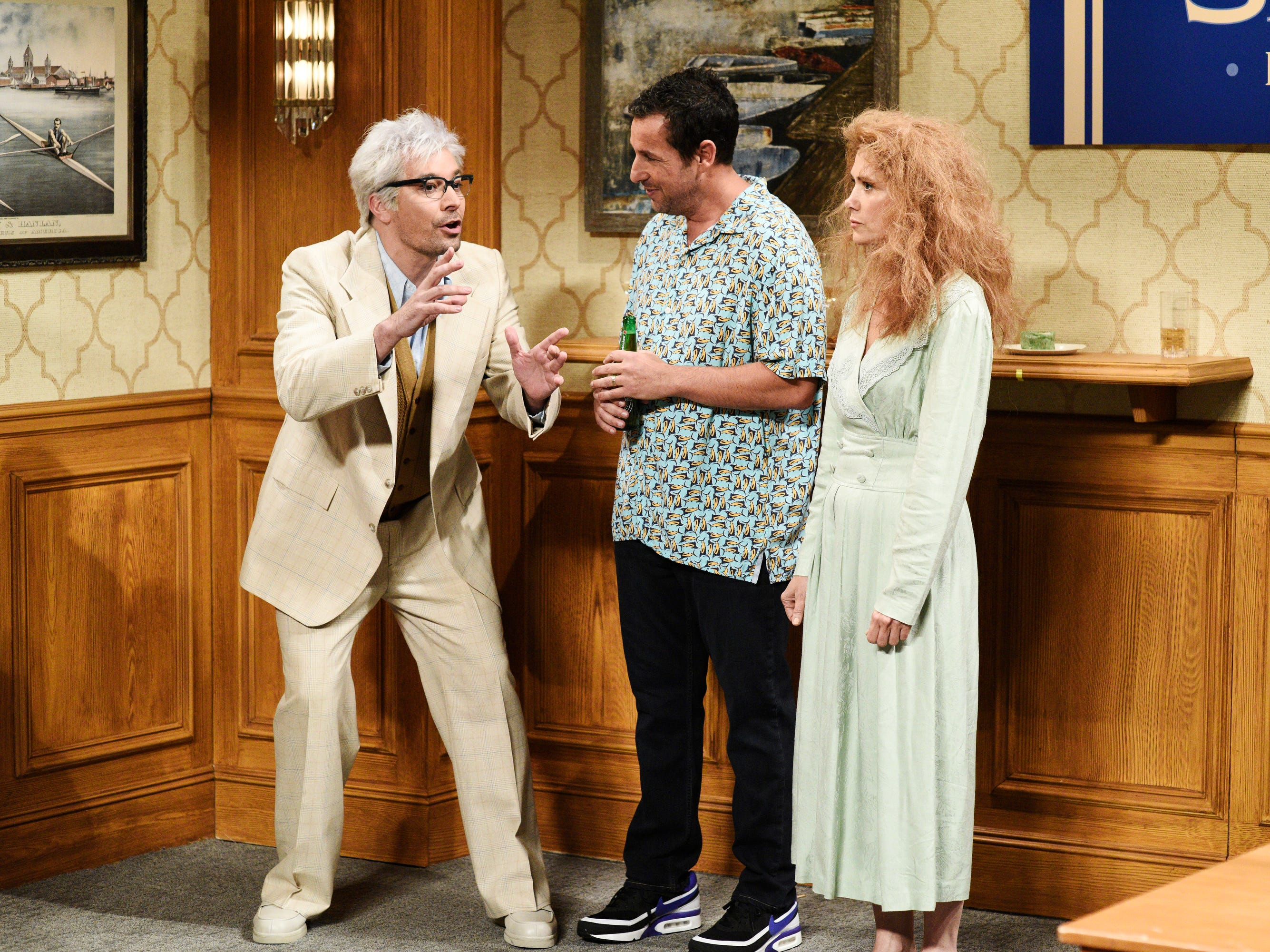 """The show also included two more surprise guests, former """"SNL"""" stars Jimmy Fallon (left) and Kristen Wiig (right), playing Sandler family members during a family reunion sketch."""