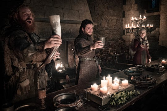 Tormund Giantsbane (Kristofer Hivju), left, Jon Snow (Kit Harington) and Daenerys Targaryen (Emilia Clarke) toast victory at the Battle of Winterfell.