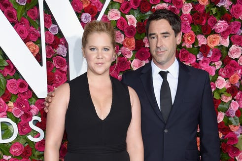 Amy Schumer and Chris Fischer.