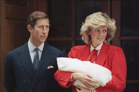 Prince Charles and Princess Diana leave St. Mary's Hospital in with their new son, Harry, on Sept. 16, 1984.