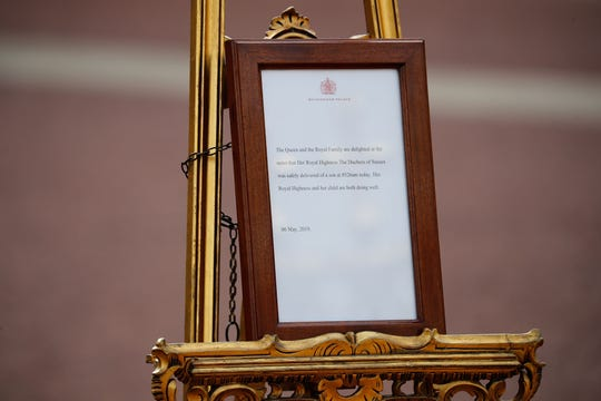The official notice of the birth of a son to Prince Harry and Duchess Meghan of Sussex is set up on an easel at the gates of Buckingham Palace on May 6, 2019.
