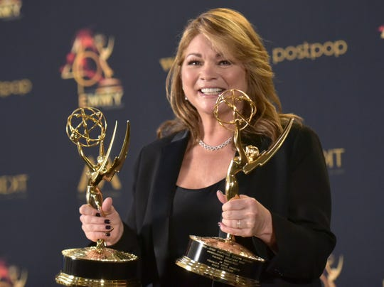"""Valerie Bertinelli poses in the press room with the awards for outstanding culinary program and outstanding culinary host for """"Valerie's Home Cooking."""""""