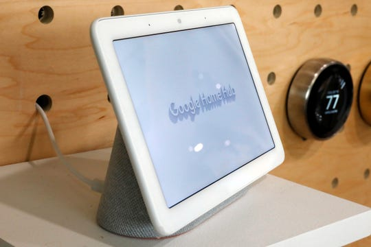 FILE- In this Oct. 9, 2018, file photo a Google Home Hub is displayed in New York. Google Assistant has made for a name for itself in a voice technology market once dominated by Amazon and Apple.