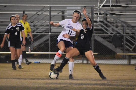 Bry Thobe wrestles the ball away from a defender.