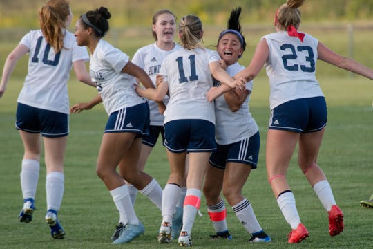 The Powdersville team celebrates after a Bry Thobe goal