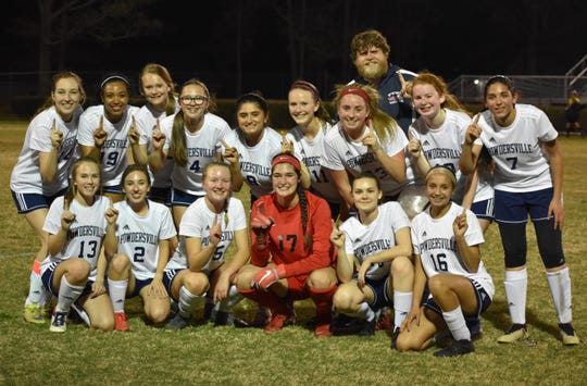 Powdersville girls socce team after finishing Region 1-AAA undefeated on April 12