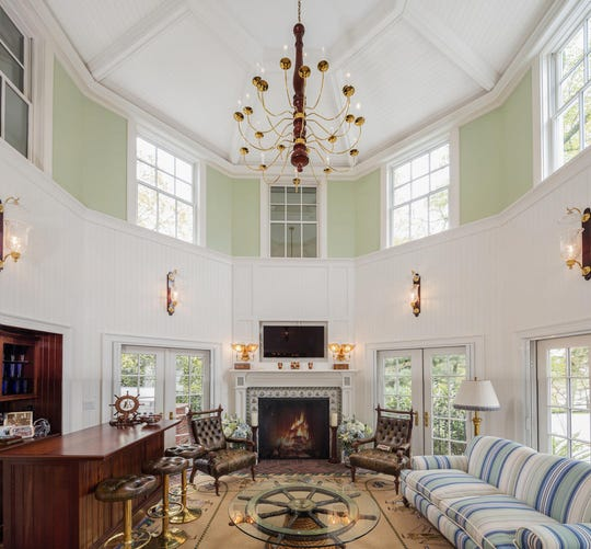 The home features high cathedral ceilings and a fireplace with a pair of french doors.