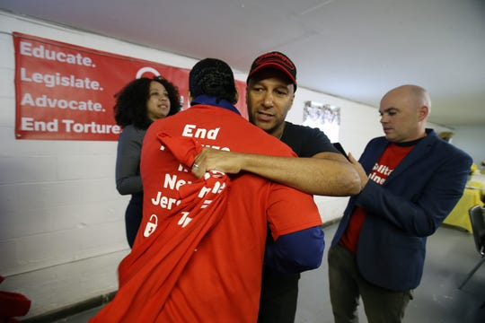 Rock icon and political activist Tom Morello, who is known for his seminal work with Rage Against the Machine, Audioslave, and the Nightwatchman, hugs Antonne Henshaw of Camden, a survivor, after meeting with survivors of solitary confinement in New Jersey prisons during an event hosted by the ACLU of New Jersey and New Jersey Campaign for Alternatives to Isolated Confinement (NJ-CAIC) at the Allen Chapel A.M.E. Church in Asbury Park, NJ Tuesday May 7, 2019.