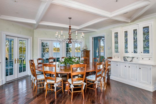 The dining room offers decorative crown molding ceilings french doors to the patio and amazing hardwood floors.