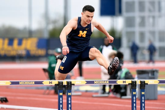 Taylor McLaughlin wins the 400 hurdles for Michigan at the Len Paddock Open.