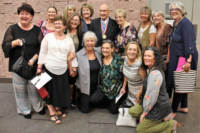 Stanley Whisenhunt, the last to be honored at the 2019 Big Country Athletic Hall of Fame inductions, is surrounded by his girls - former Wylie High School players who helped him win 15 straight district championships and make two state basketball tournament appearances.  He also served as Wylie  ISD superintendent.