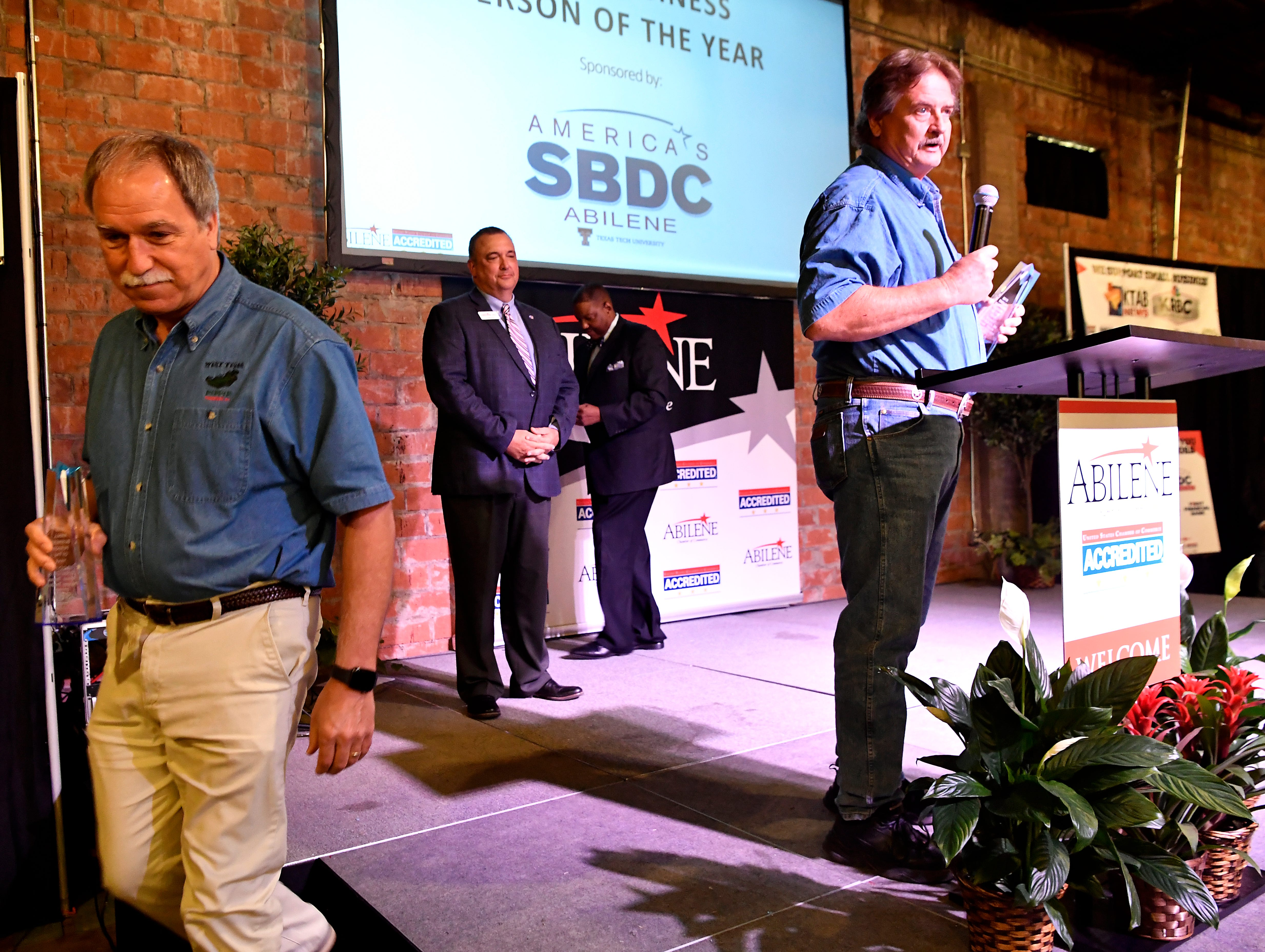 Scott Bridges expresses his thanks Tuesday after he and Tony Spradlin (left) were named Small Business Persons of the Year at Tuesday's Salute to Small Business luncheon at 201 Mesquite Event Center. The duo own West Texas Pepper Traders.
