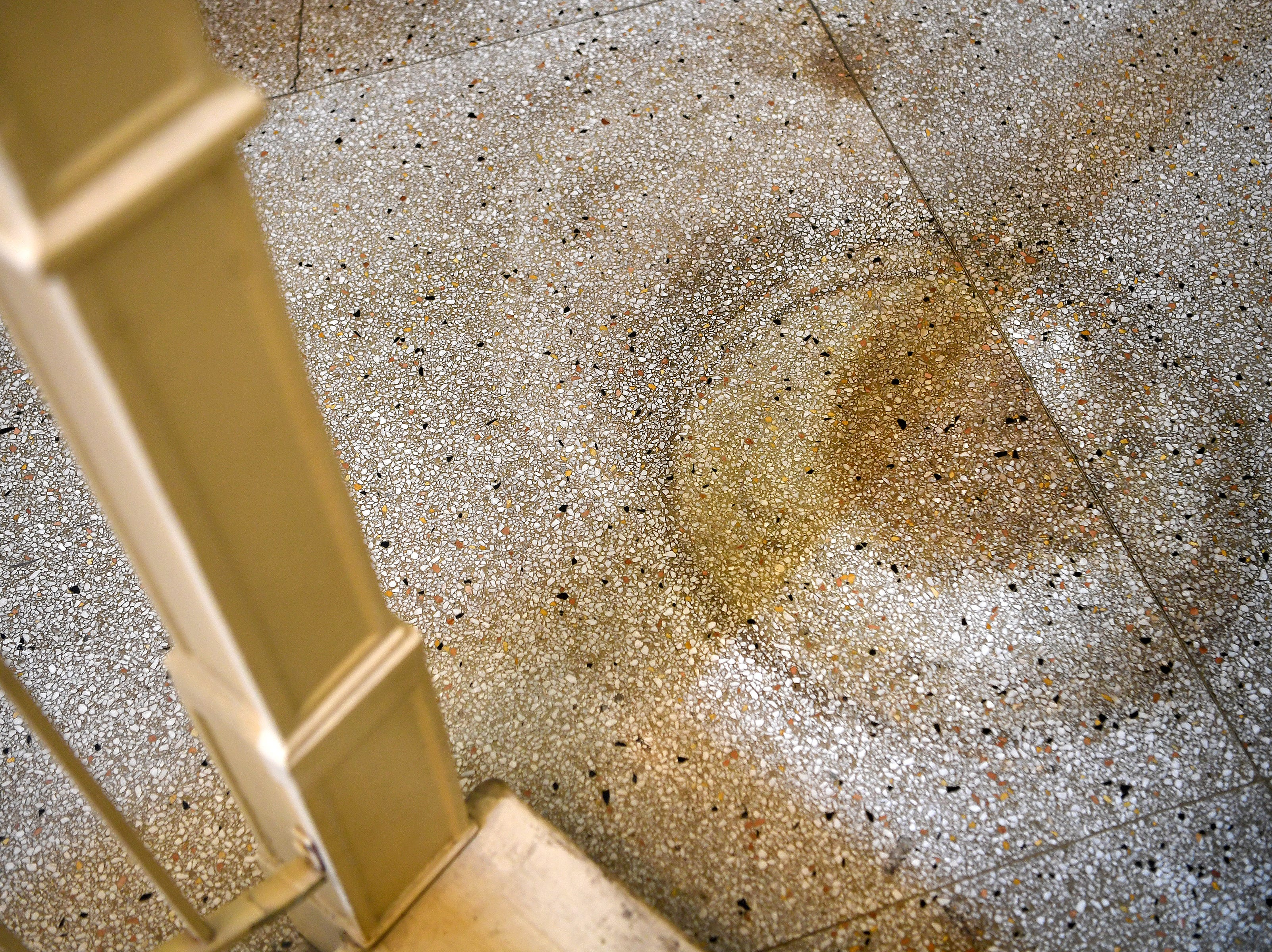 Damage from an old barber's chair marks the floor of the Flatiron Building downtown. There was once a barber shop in that part of the building.