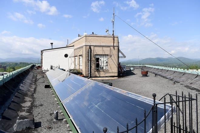 Duke Energy does have a solar power rebate program, but some residents say it's hard to get past the wait list. This file photo shows solar panels on the roof of the Flatiron Building downtown.