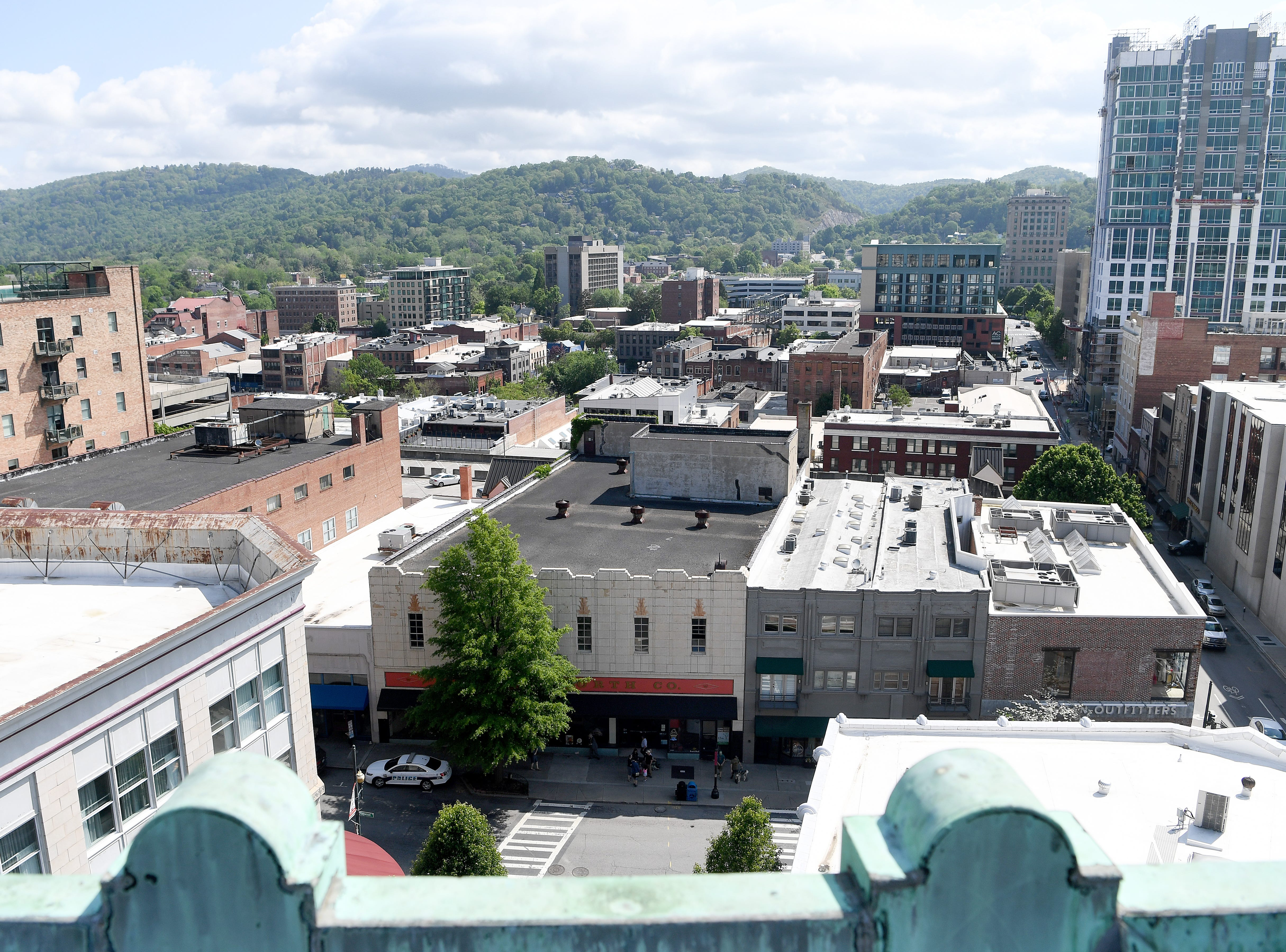 The view from the roof of the Flatiron Building shows downtown Asheville and beyond.