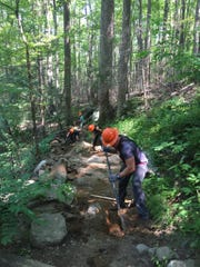 Trail workers rehabilitate the Rainbow Falls Trail in Great Smoky Mountains National Park. Work will begin May 13 on the Trillium Gap Trail in the Smokies.