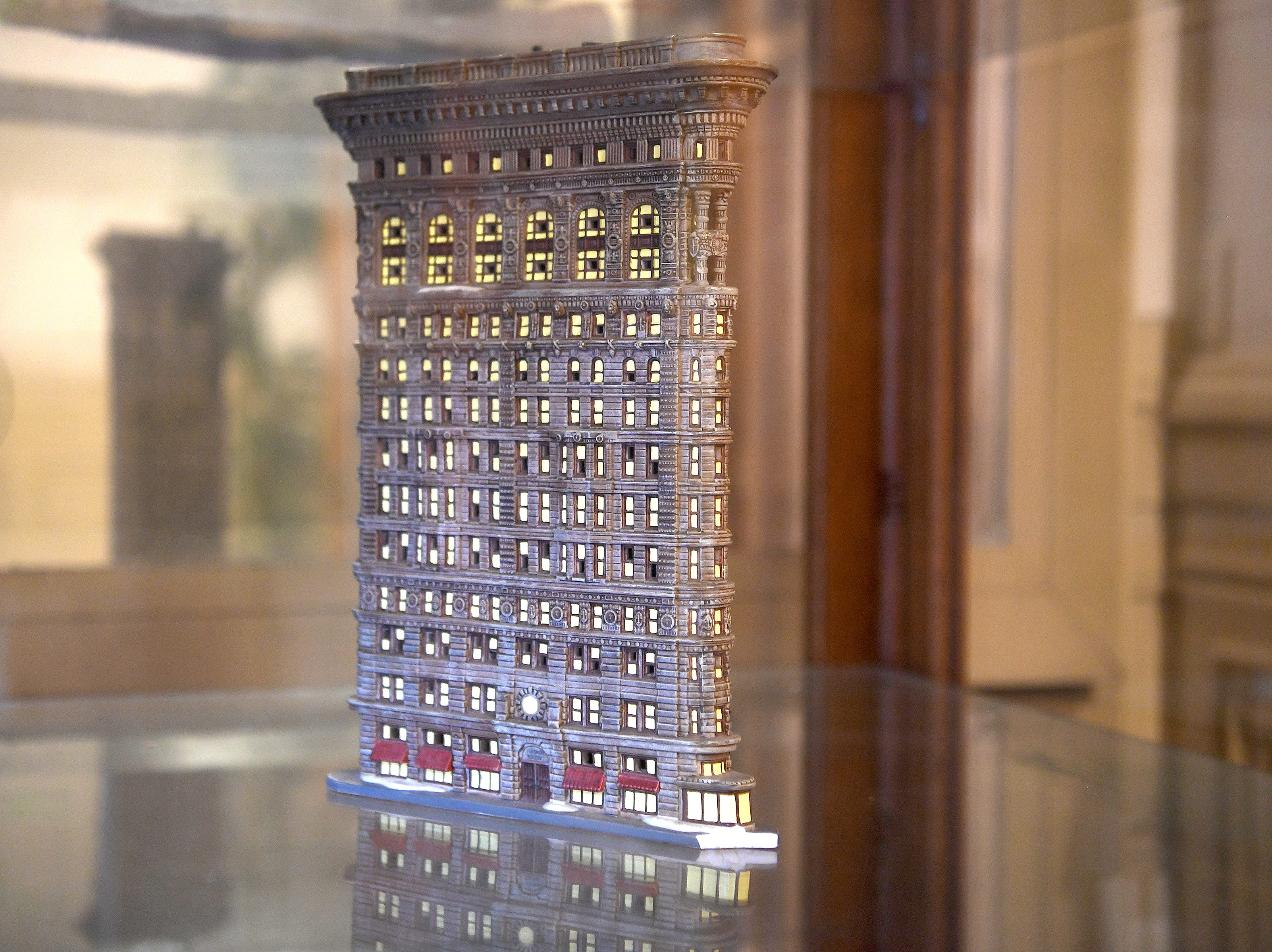 A model of the Flatiron Building in New York City is displayed in a case in the Flatiron Building in Asheville.