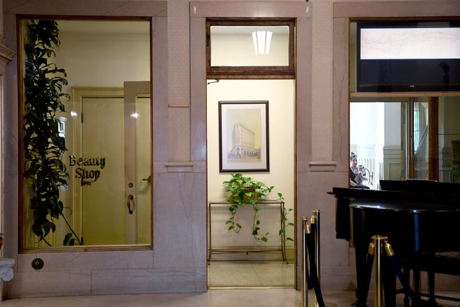 A rendering of Asheville's Flatiron Building hangs in a doorway from the lobby of the downtown building.