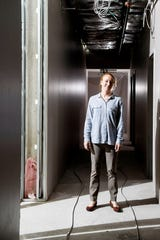 Diana Wortham Theatre managing director Rae Geoffrey, in a hallway that is under construction on May 6, took over her role in 2017 and has led the theater through a major capital campaign.