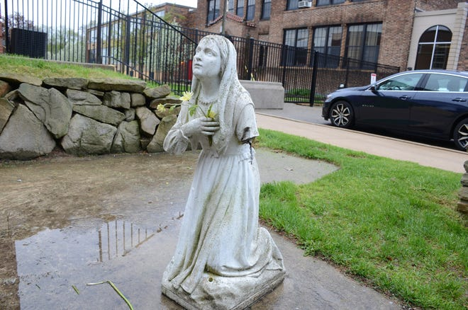 The statue of Saint Bernadette outside St. Philip Catholic Church was damaged Sunday.