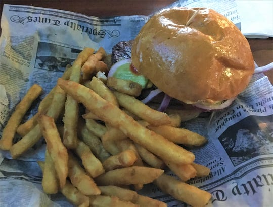 The burgers stack up among the best in the area, including the 1-pound McGonigle's Burger.