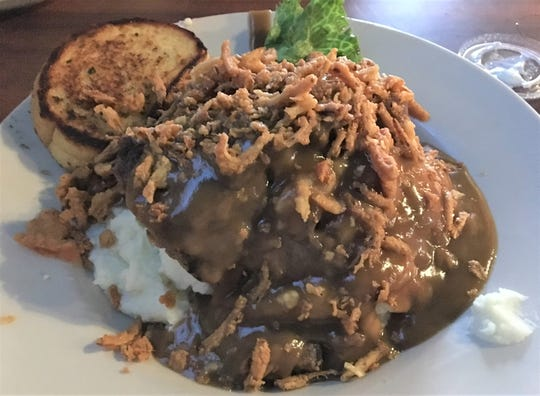 The Mile High Meatloaf stands out as one of the top choices on the dinner menu at McGonigle's Pub & Grill.