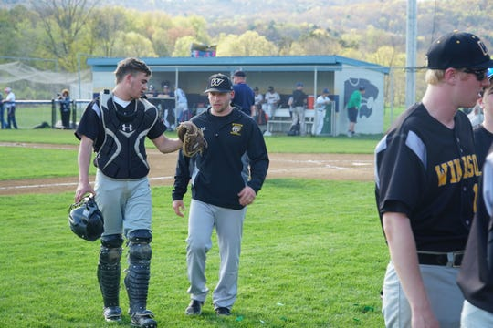 Windsor coach Brandon Olbrys talks with catcher Kyle Bowling during the Black Knights' 5-1 loss at Susquehanna Valley on Thursday. Olbrys is in first season as Windsor's coach and has the Black Knights off to an 11-4 start.