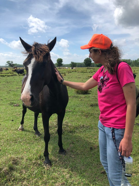 Luisa Borda, 20, of Melbourne has been attending CIP Brevard since January 2019. Borda recently participated in the Eye of a Horse equine program in Central Florida, where CIP Brevard students gain leadership, non-verbal communication, and other critical interpersonal skills as they spend time socializing with horses.