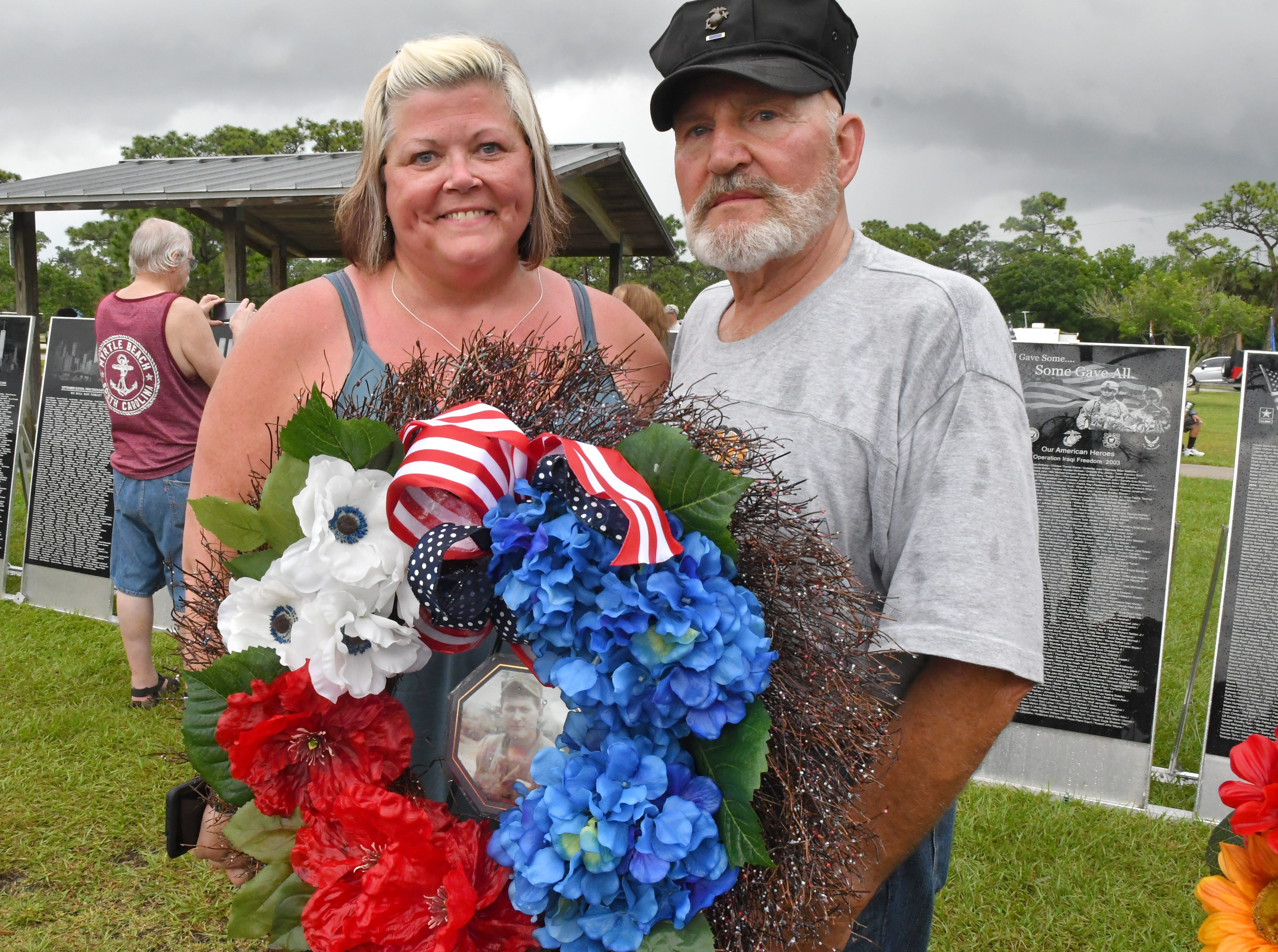 Kimberlee Thompson, whose father, James Borawski, was killed in Vietnam in May of 1967 by the same mortar shell that wounded fellow Marine Ben Bydalek of Melbourne, seen here at right. Kimberlee, of Kansas City, and Ben met last November and have become friends. They placed a wreath in memory of her father at Monday's presentation of wreaths and opening ceremony at the Vietnam Traveling Memorial Wall, which will be set up until May 12. It is part of The 32nd Annual Vietnam and All Veterans Reunion, a free event open to the public at Wickham Park in Melbourne May 9-12.