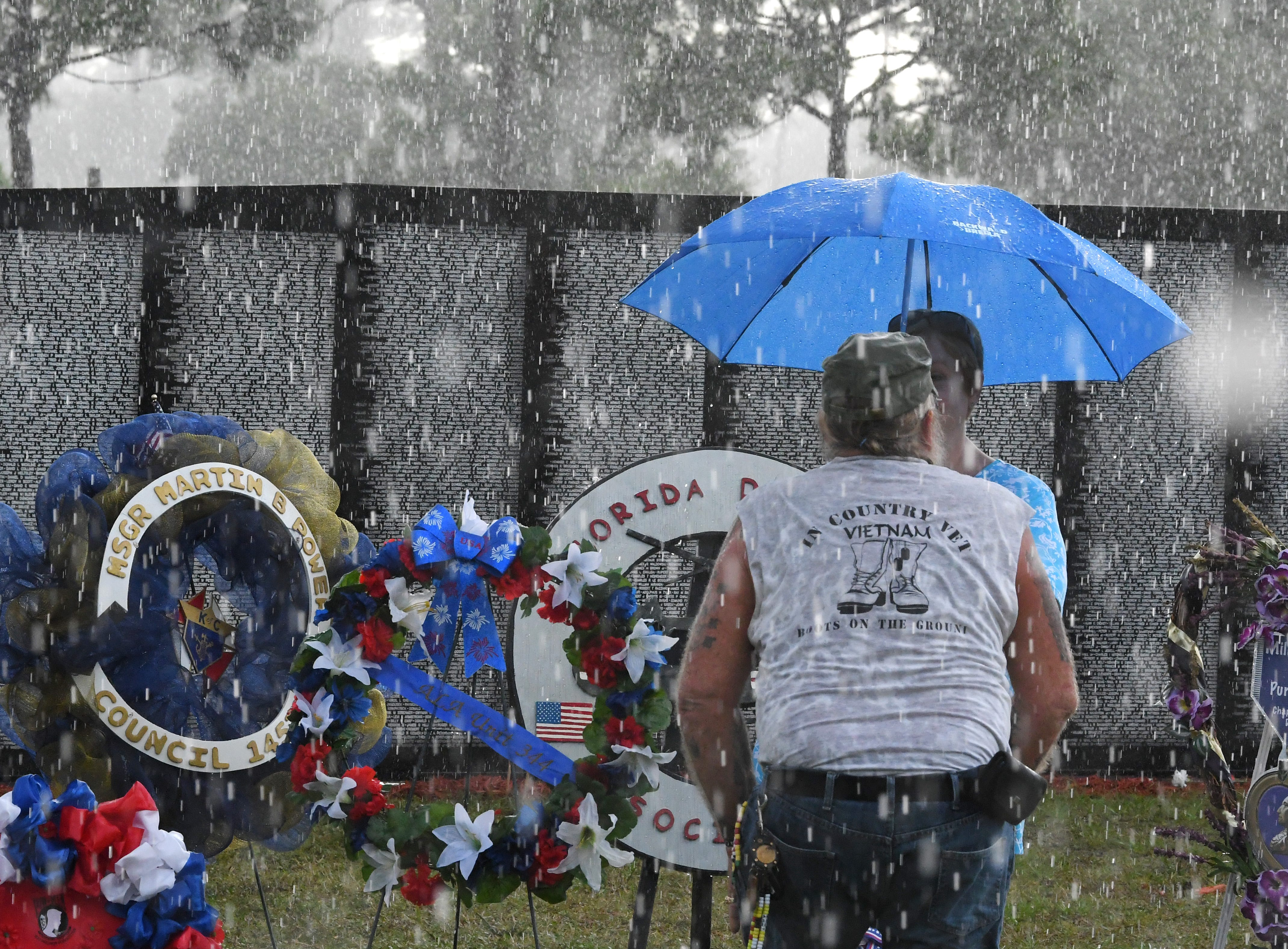 For several minutes, heavy rain hit the area. Monday's presentation of wreaths and opening ceremony at the Vietnam Traveling Memorial Wall, which will be set up until May 12. It is part of The 32nd Annual Vietnam and All Veterans Reunion, a free event open to the public at Wickham Park in Melbourne May 9-12.