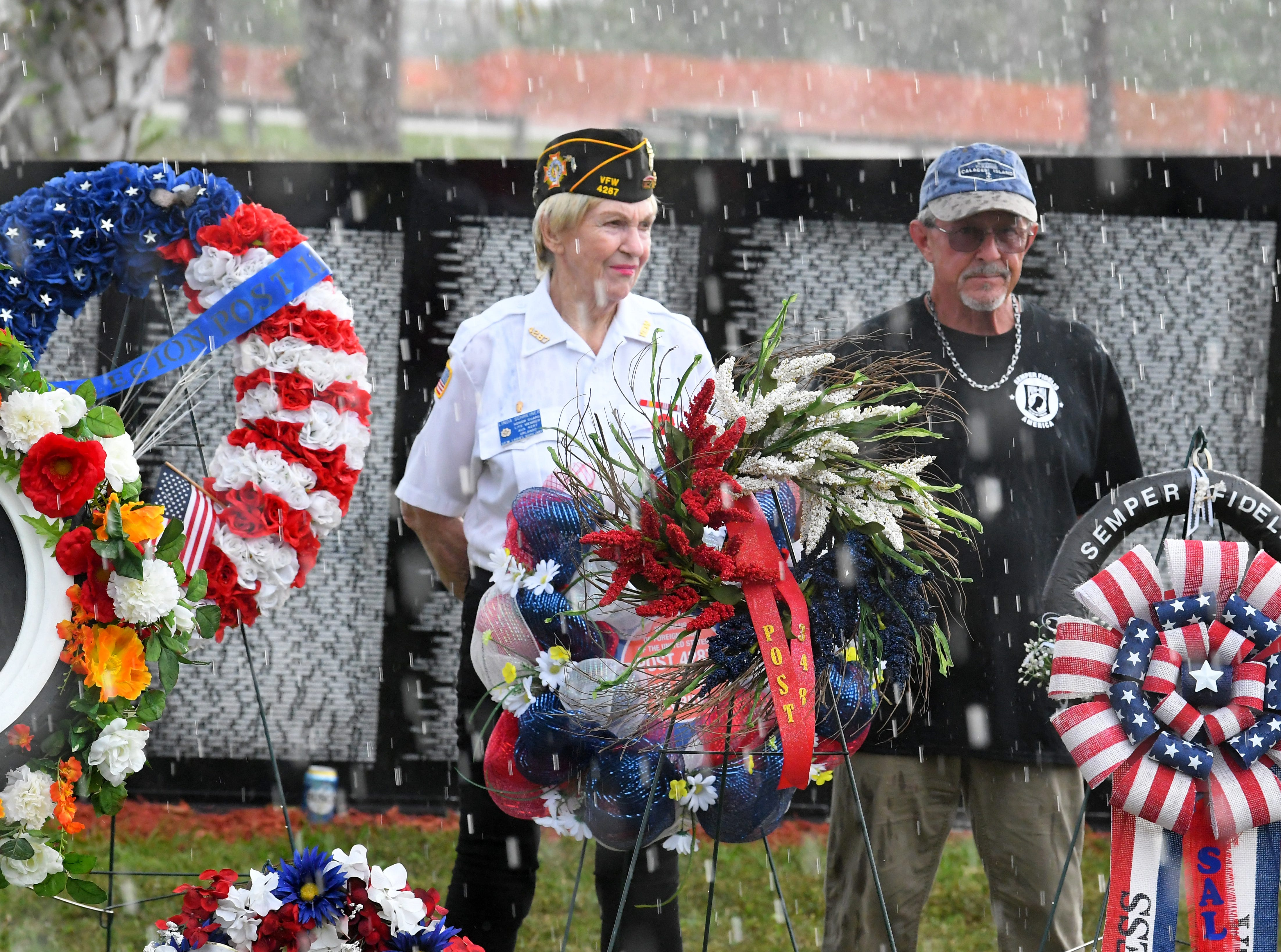 Most participants sough shelter while a brief but heavy rain began. But not 8 year old Ajalynn Fields, who continued to salute for several minutes in front of the wreath for the Veterans Transitional Facility. Monday's presentation of wreaths and opening ceremony at the Vietnam Traveling Memorial Wall, which will be set up until May 12. It is part of The 32nd Annual Vietnam and All Veterans Reunion, a free event open to the public at Wickham Park in Melbourne May 9-12.