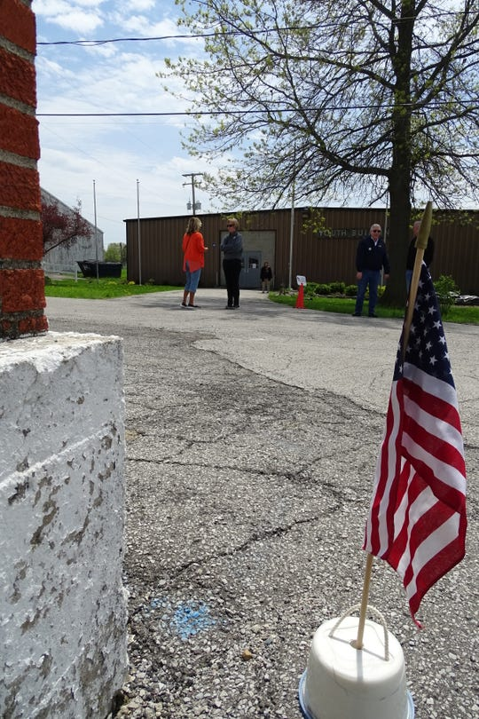 People chat outside the polling place at the Crawford County Fairgrounds on Tuesday.