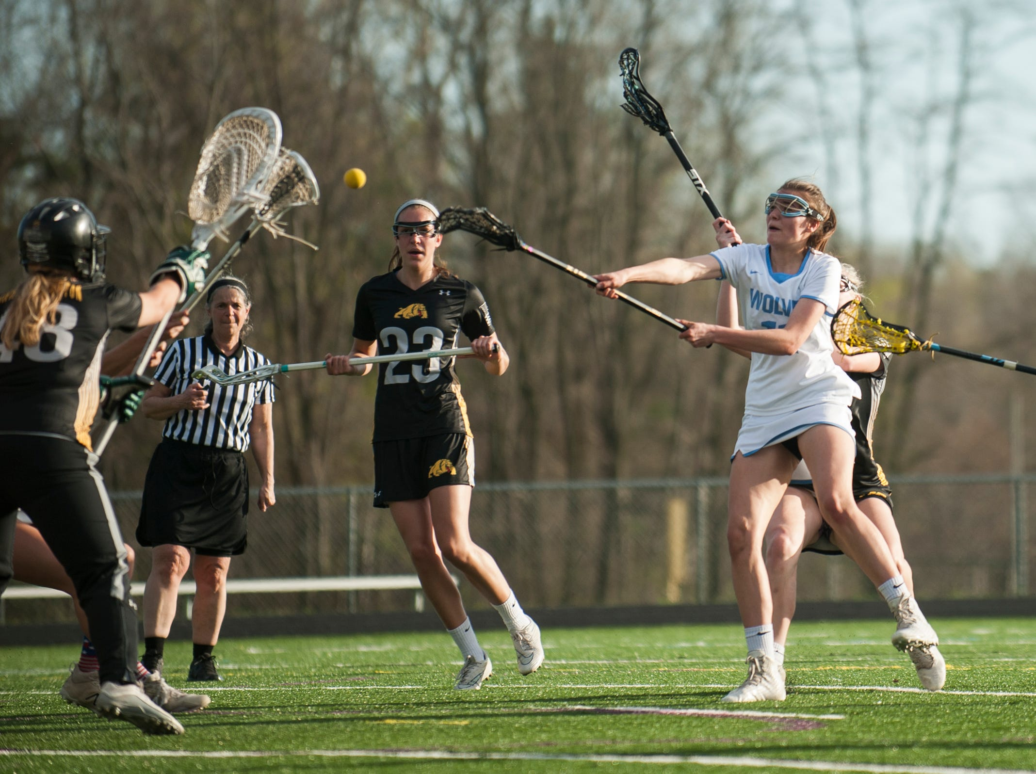 South Burlington's Christina March (11) shoots the ball during the high school girls lacrosse game between Burr and Burton Bulldogs and the South Burlington Wolves at Munson Field on Monday afternoon May 6, 2019 in South Burlington, Vermont.