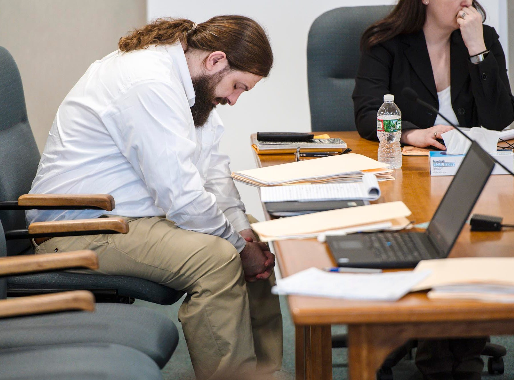 Steven Bourgoin bends his head during a break in his murder trial in Vermont Superior Court in Burlington on Tuesday, May 7, 2019. Bourgoin is facing five counts of second-degree murder for a crash that killed five teenagers on I-89 in Williston in 2016. Pool photo by Glenn Russell/VTDigger