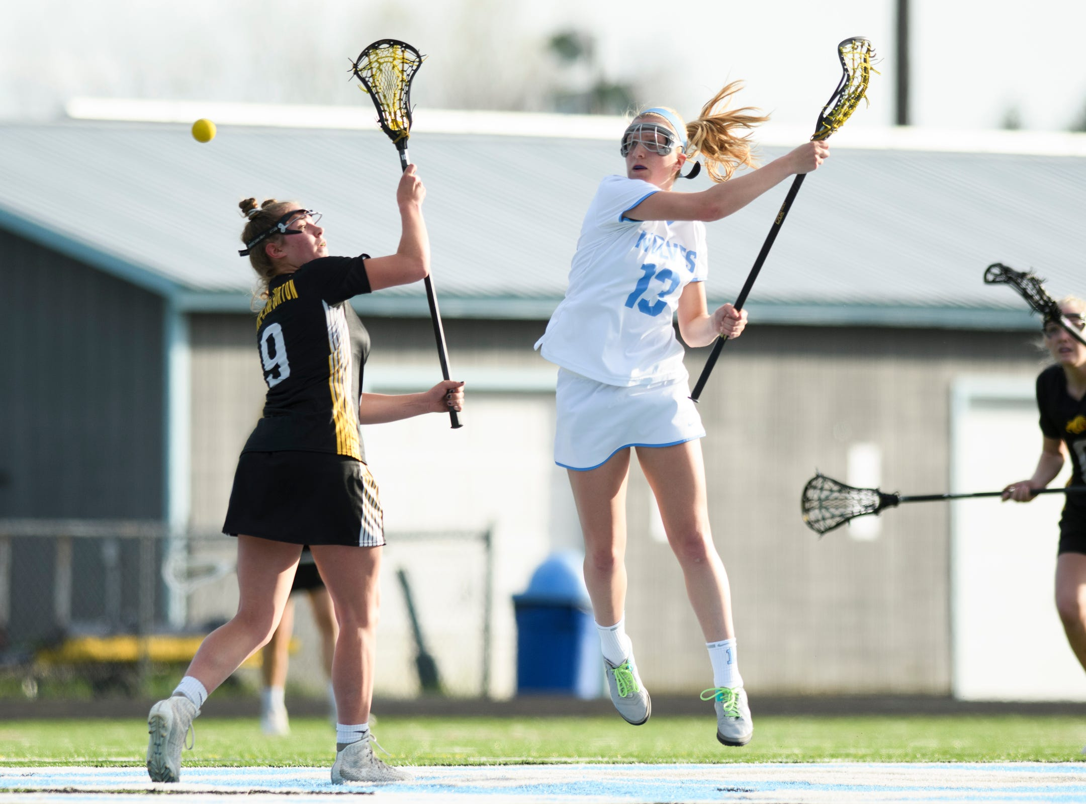 South Burlington's Caroline Desautels (13) and Burr and Burton's Julia Fillion (9) battle for the tip off during the high school girls lacrosse game between Burr and Burton Bulldogs and the South Burlington Wolves at Munson Field on Monday afternoon May 6, 2019 in South Burlington, Vermont.