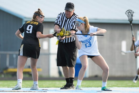 South Burlington's Caroline Desautels (13) and Burr and Burton's Julia Fillion (9) wait for the tip off during the high school girls lacrosse game between Burr and Burton Bulldogs and the South Burlington Wolves at Munson Field on Monday afternoon May 6, 2019 in South Burlington, Vermont.