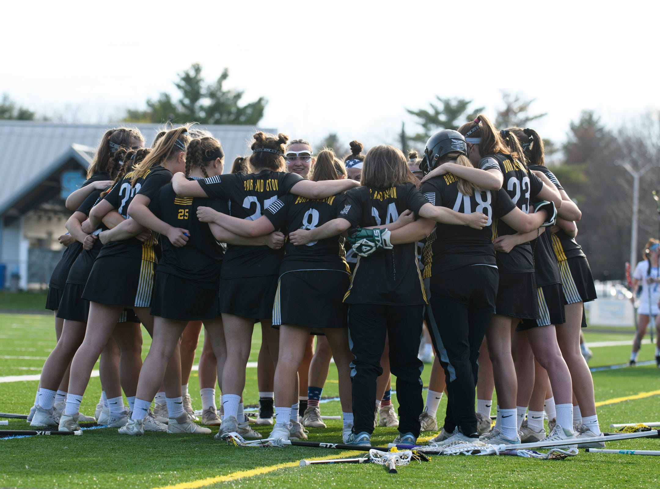 Burr and Burton huddles together during the high school girls lacrosse game between Burr and Burton Bulldogs and the South Burlington Wolves at Munson Field on Monday afternoon May 6, 2019 in South Burlington, Vermont.