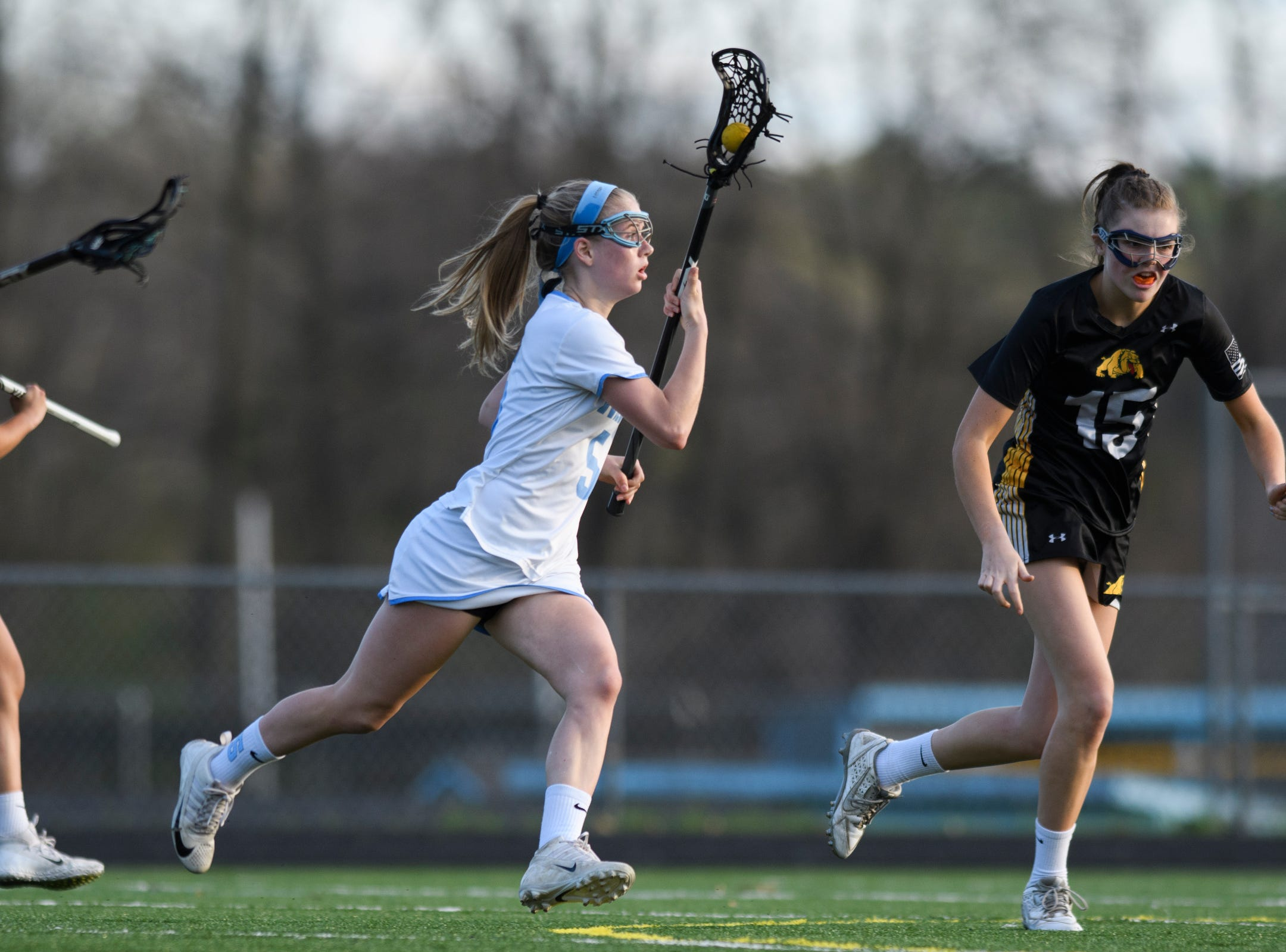 South Burlington's Lilly Truchon (15) runs down the field with the ball during the high school girls lacrosse game between Burr and Burton Bulldogs and the South Burlington Wolves at Munson Field on Monday afternoon May 6, 2019 in South Burlington, Vermont.