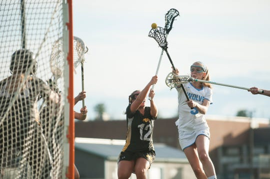 South Burlington's Lindsey Booth (3) shoots the ball during the high school girls lacrosse game between Burr and Burton Bulldogs and the South Burlington Wolves at Munson Field on Monday afternoon May 6, 2019 in South Burlington, Vermont.