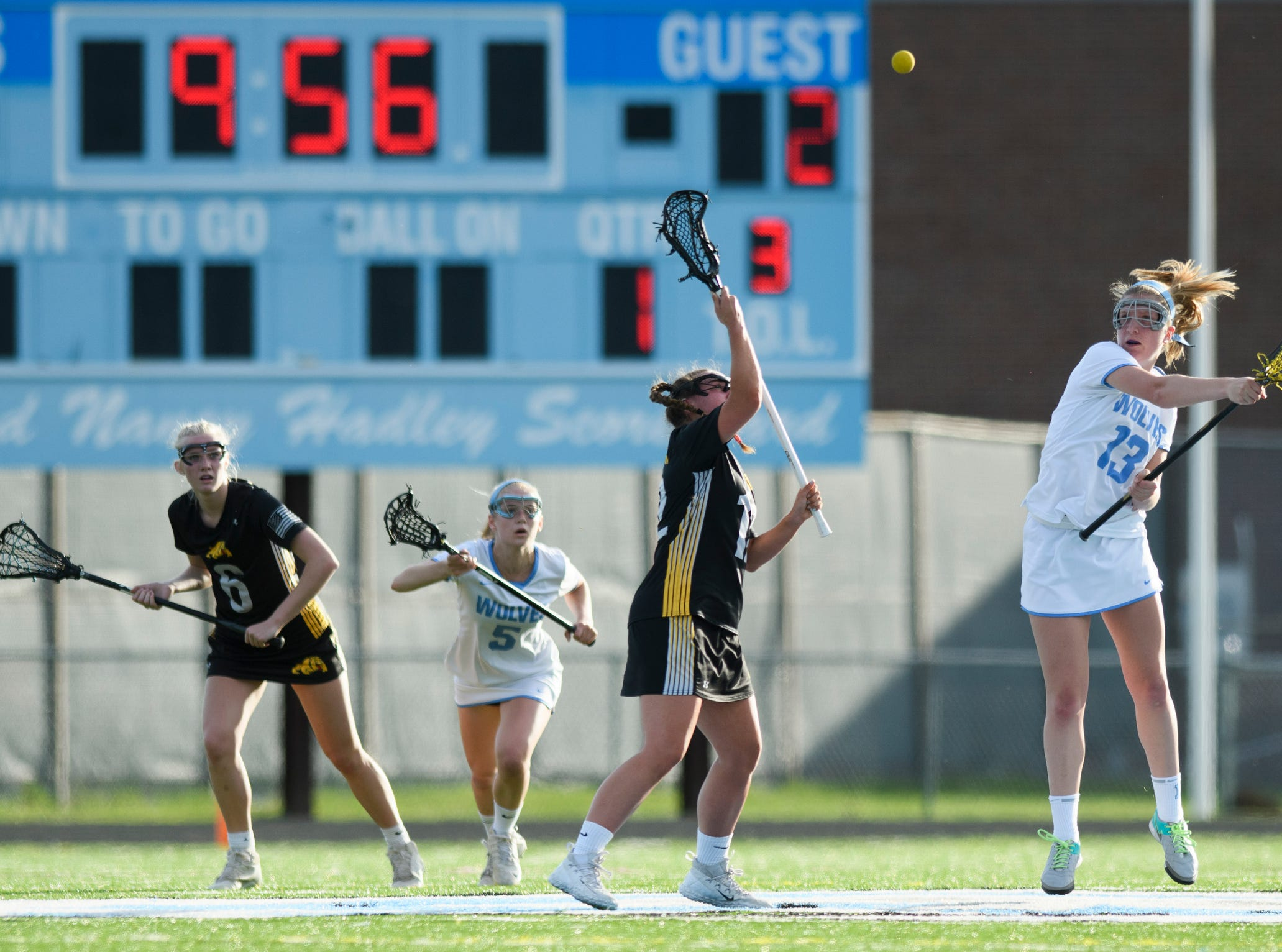 South Burlington's Caroline Desautels (13) and Burr and Burton's Olivia Watanabe (12) battle for the tip off during the high school girls lacrosse game between Burr and Burton Bulldogs and the South Burlington Wolves at Munson Field on Monday afternoon May 6, 2019 in South Burlington, Vermont.