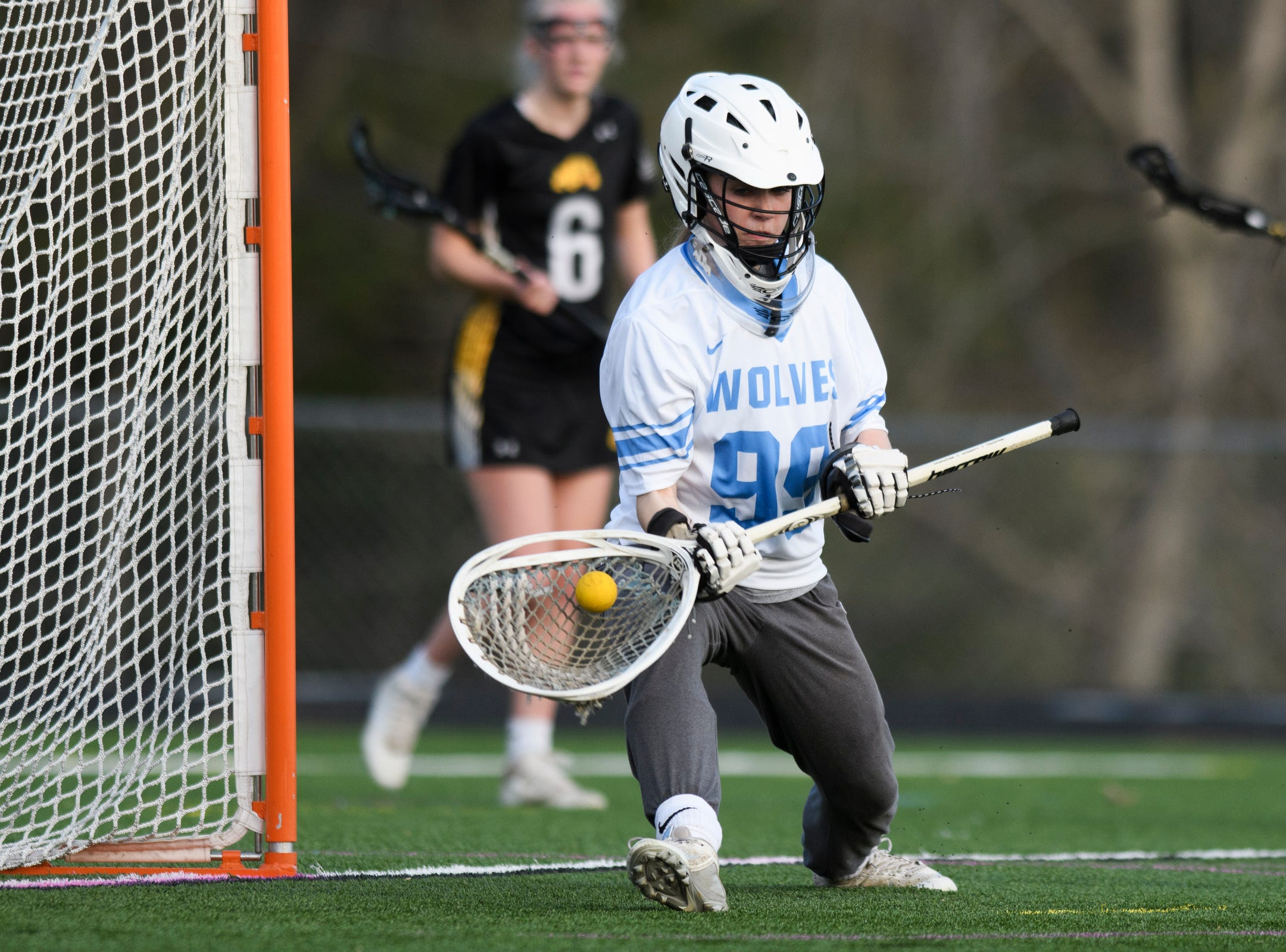 South Burlington goalie Claire Phillips (99) makes a save during the high school girls lacrosse game between Burr and Burton Bulldogs and the South Burlington Wolves at Munson Field on Monday afternoon May 6, 2019 in South Burlington, Vermont.